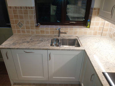 New kitchen with granite worktops and recessed drainer.